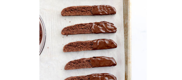 chocolate dipped biscotti on pan