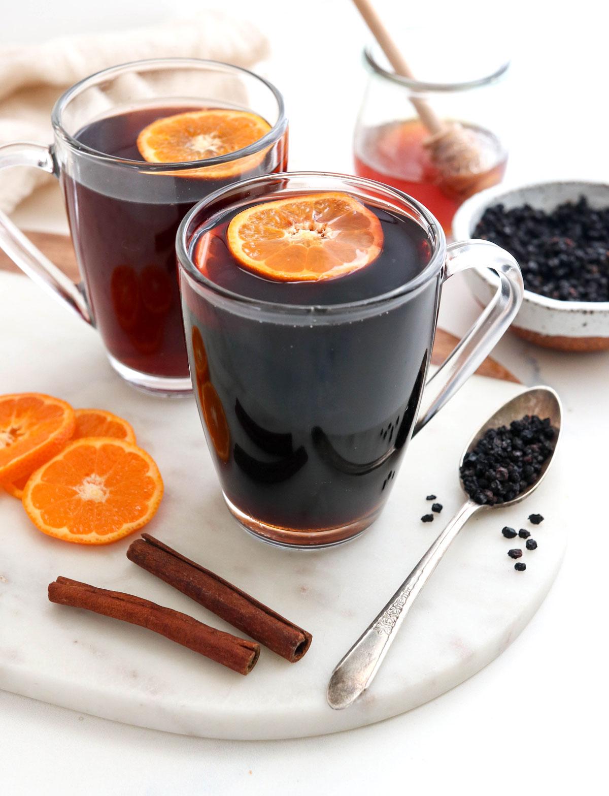 orange slices floating in elderberry tea