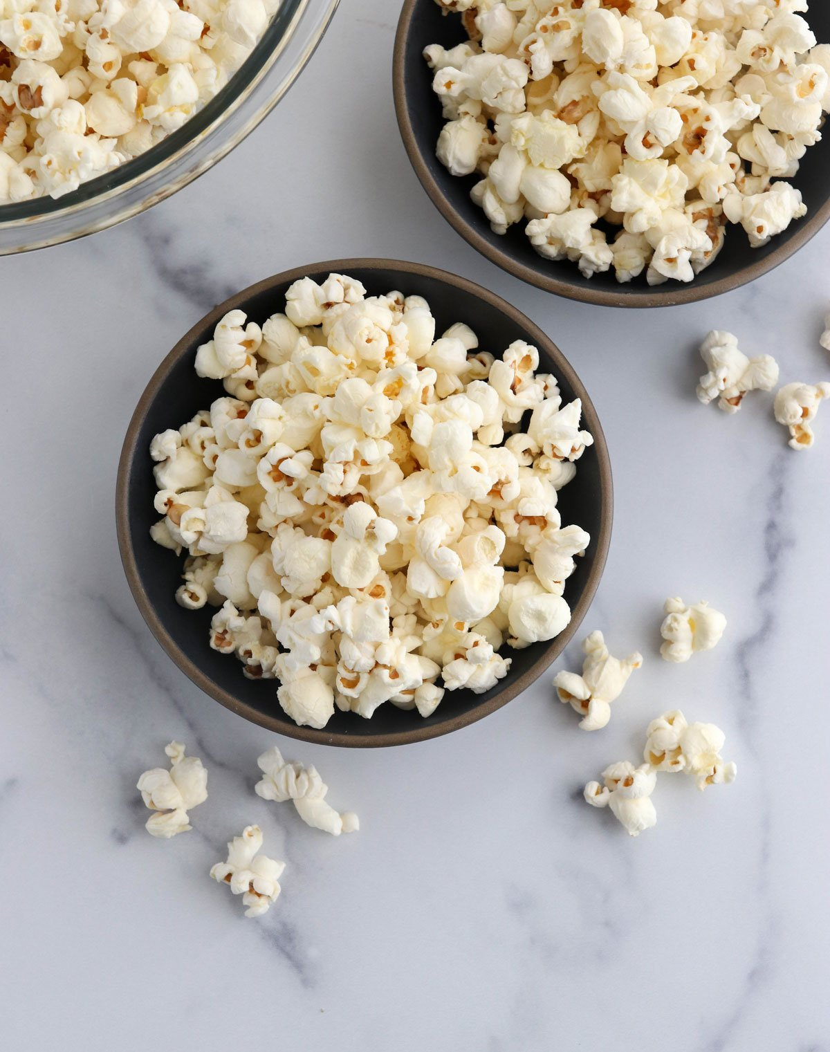 popcorn in two black bowls