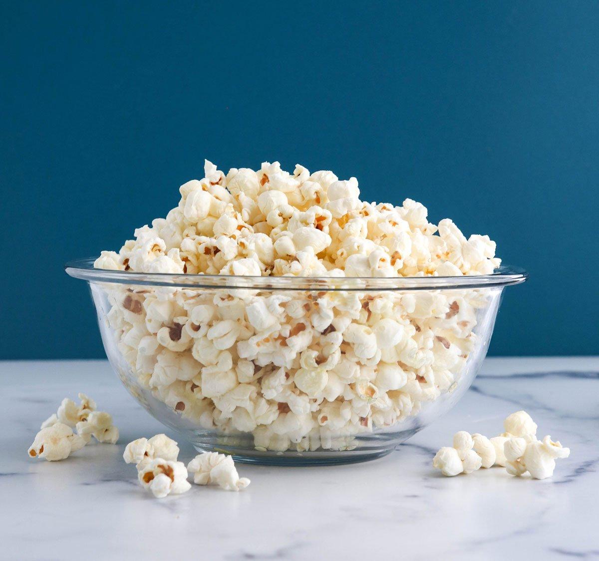 popcorn heaped in glass bowl