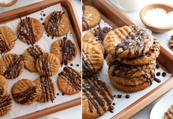 chocolate drizzled on cookies on baking sheet