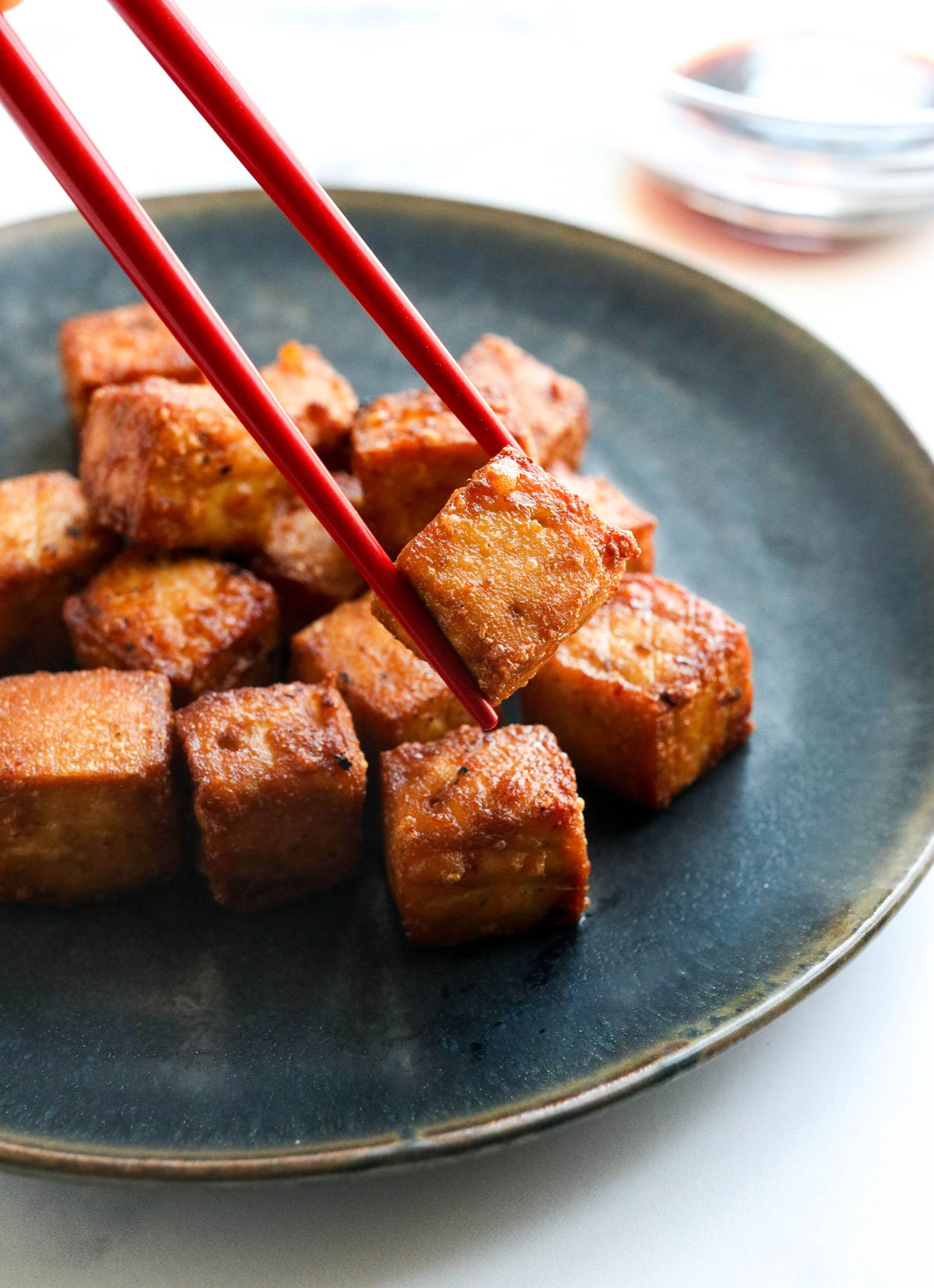 tofu lifted by chopsticks