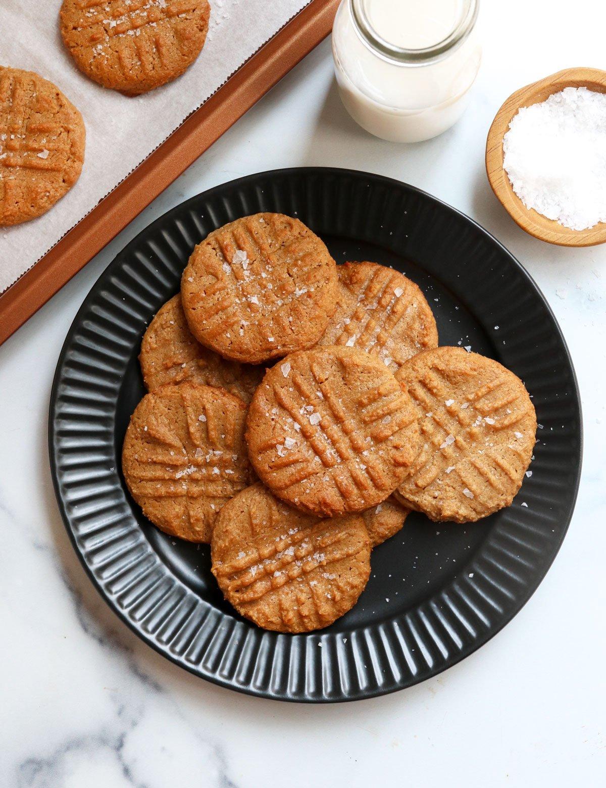 flourless peanut butter cookies on black plate