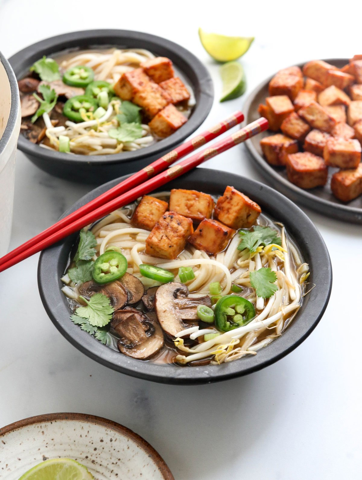 vegetarian pho topped with tofu and bean sprouts