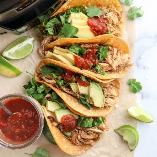 slow cooker chicken tacos stacked together