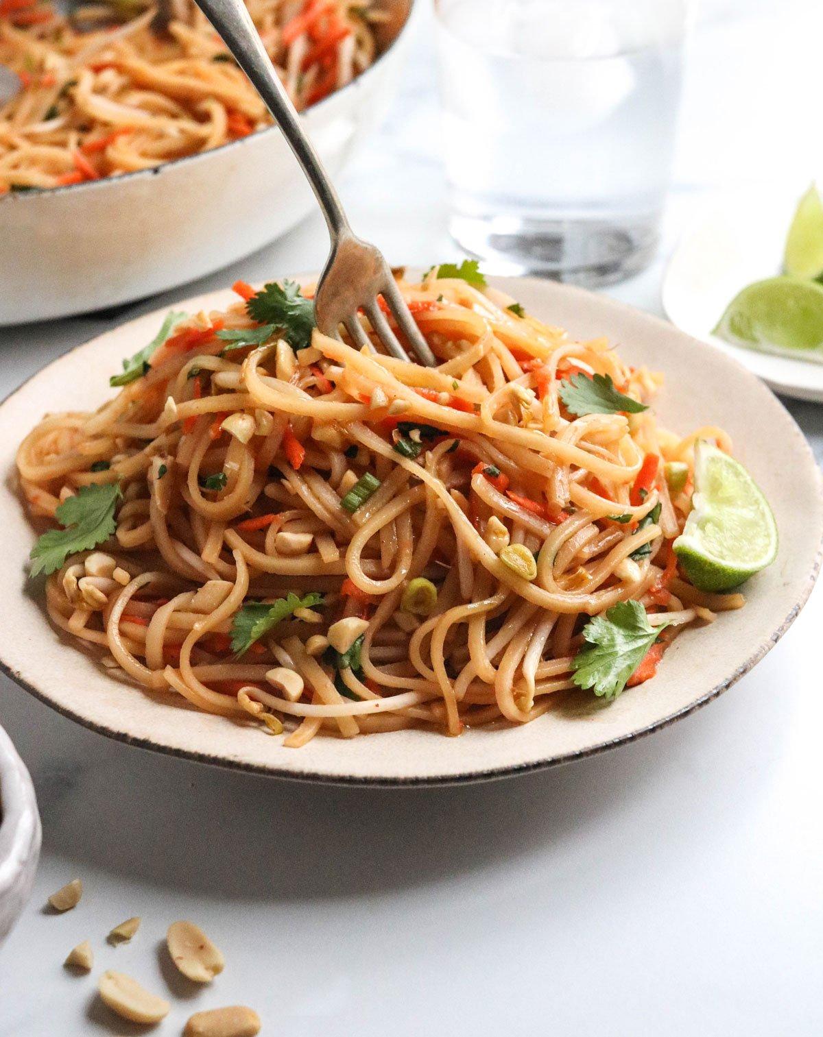vegan pad thai twirled on fork