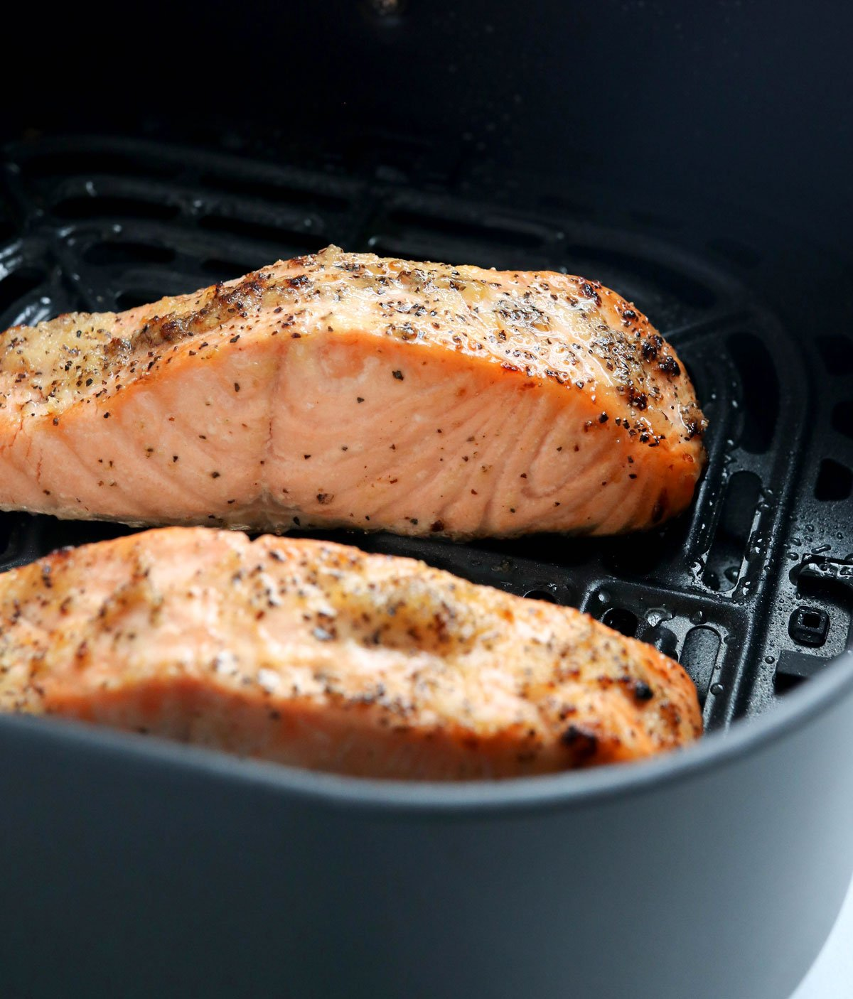 cooked salmon in the air fryer basket