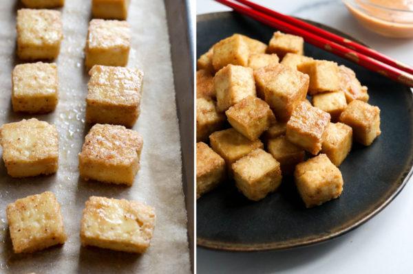crispy baked tofu served on black plate