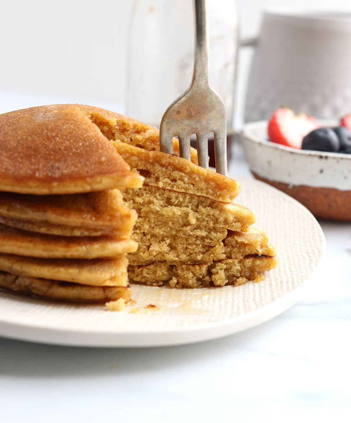 oat flour pancakes with fork inside