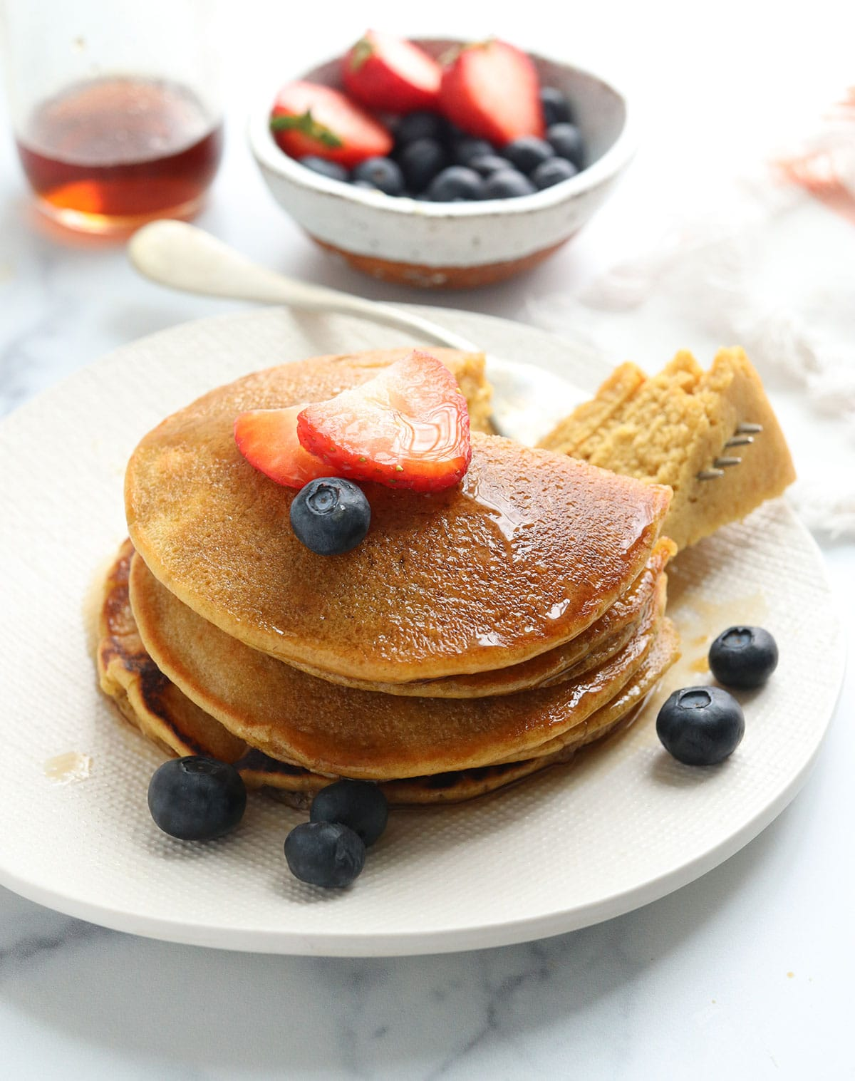oat flour pancakes with fruit on top