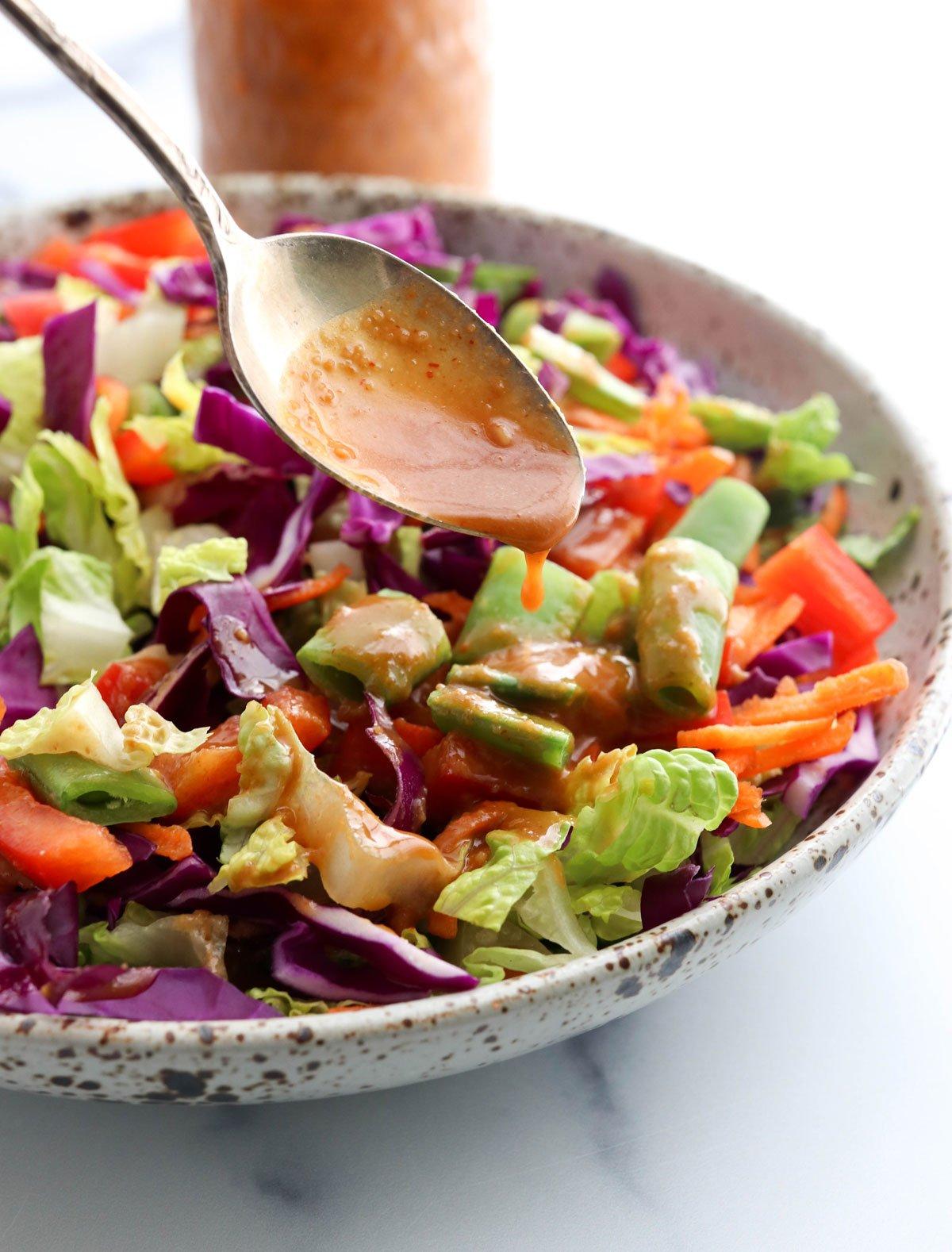 peanut dressing poured over salad