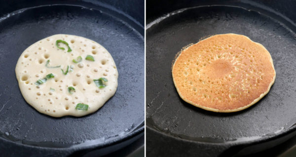 chopped green onions added to pancake and flipped