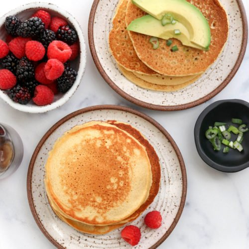 chickpea pancakes topped with avocado and berries
