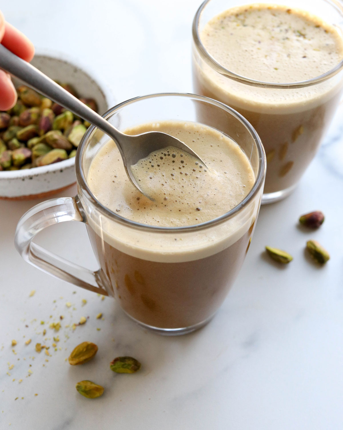 pistachio latte with spoon of foam