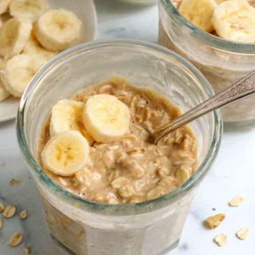 banana overnight oats in a jar with a spoon