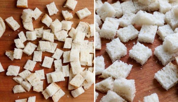 bread cut into cubes on cutting board