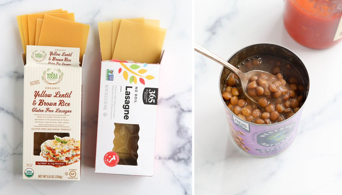 lasagna noodles and canned lentils on marble surface