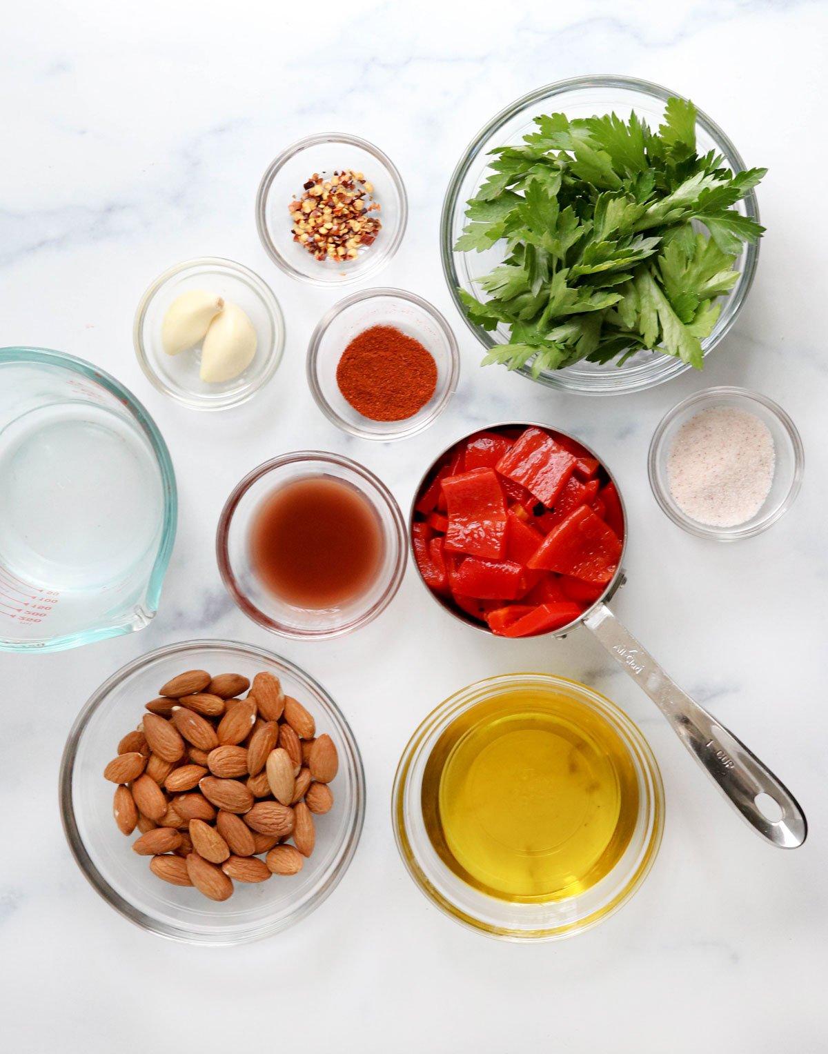 romesco sauce ingredients on white surface