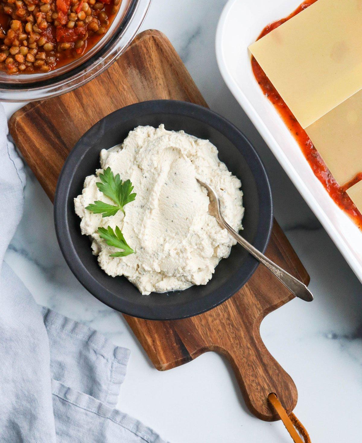 vegan ricotta next to lasagna ingredients