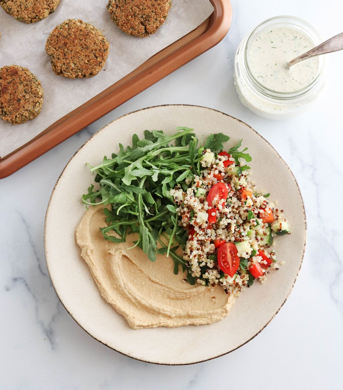 falafel bowl components added to large plate