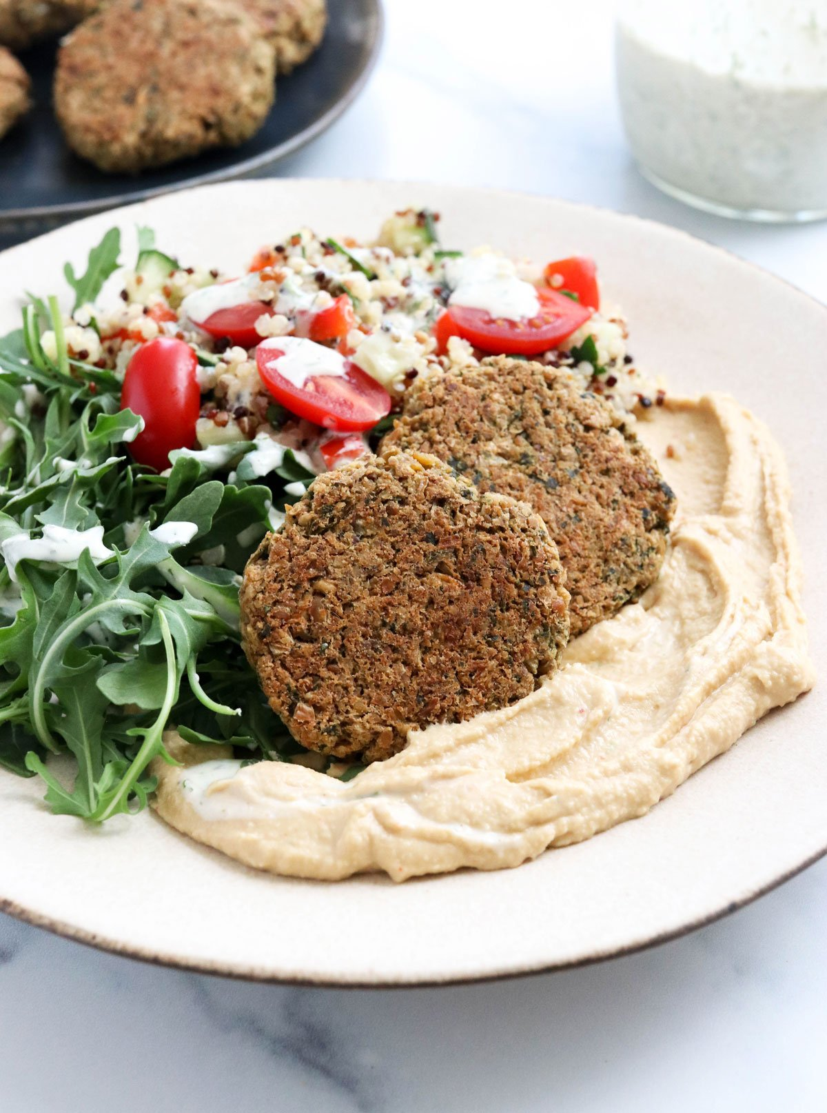 baked falafel on plate with hummus