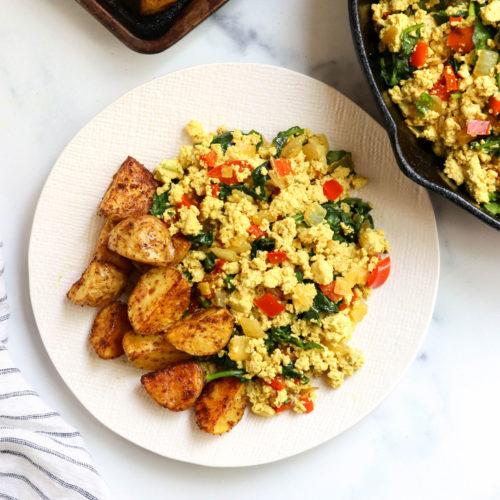 tofu scramble on plate with potatoes
