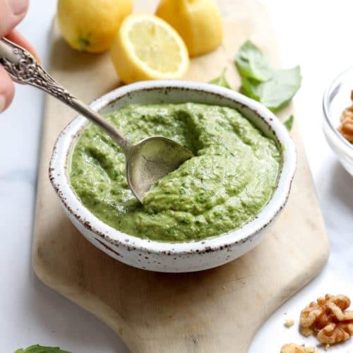 vegan pesto with spoon and lemons