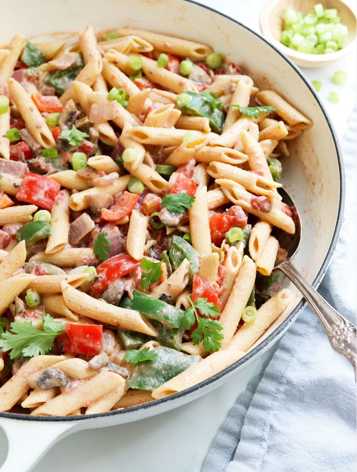 cajun pasta ready to be served from white skillet