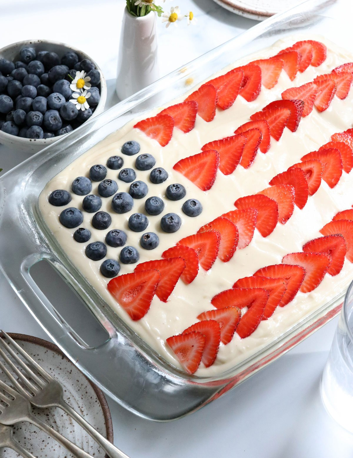 oat flour flag cake topped with berries