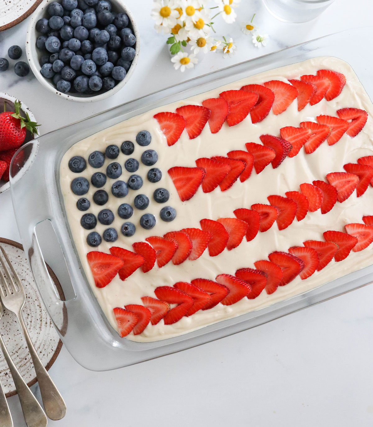 finished flag cake by bowl of berries