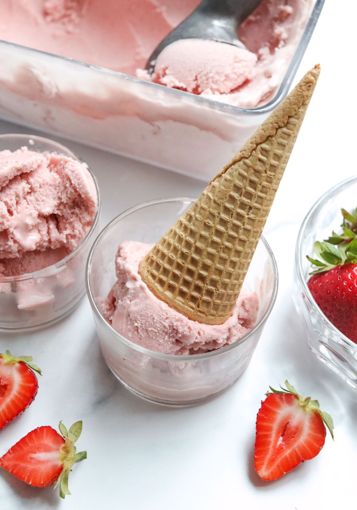 strawberry ice cream with cone and strawberries
