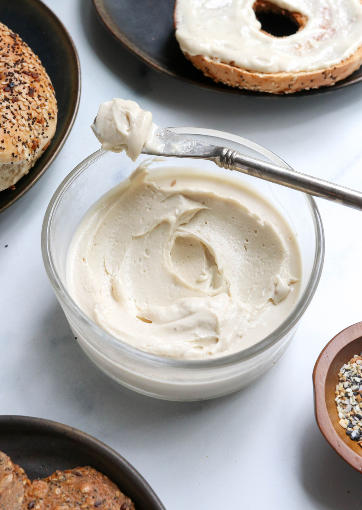 vegan cream cheese with knife on the container