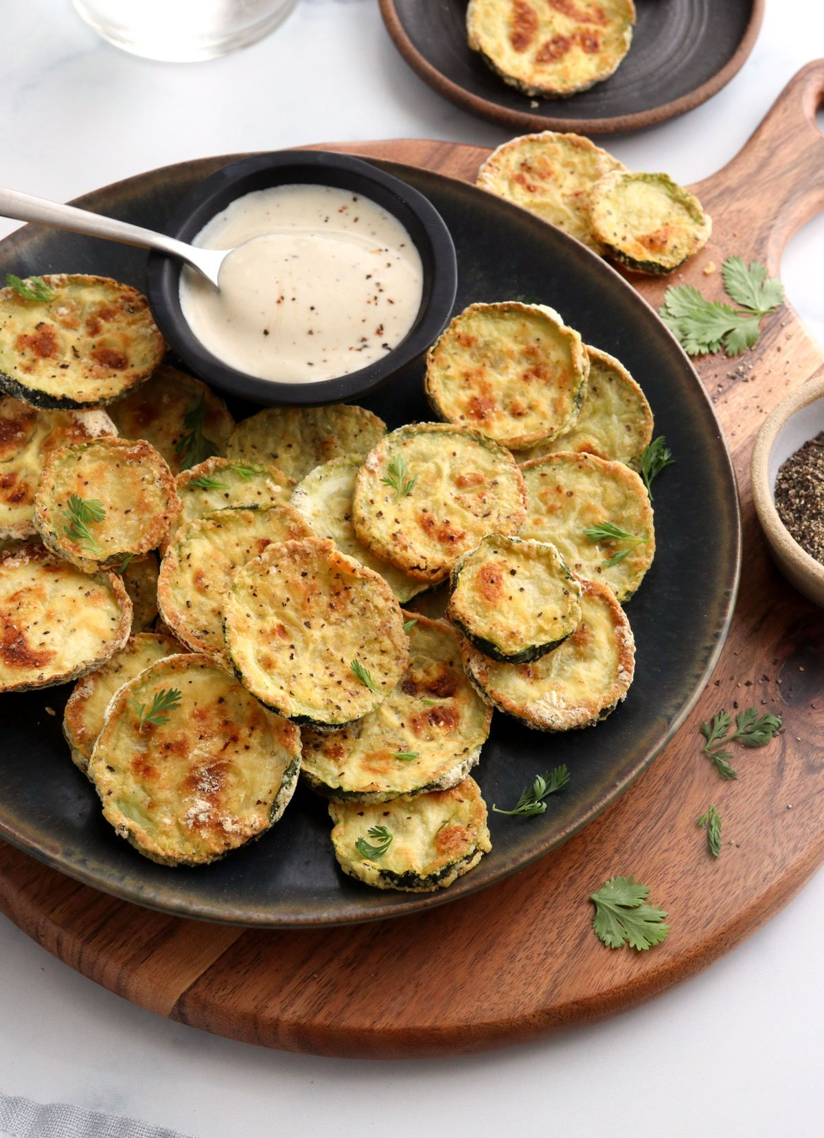 air fryer zucchini slices on black plate