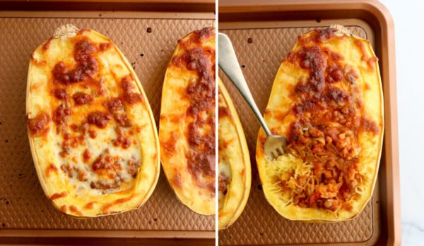 baked spaghetti squash with a fork mixing in the strands