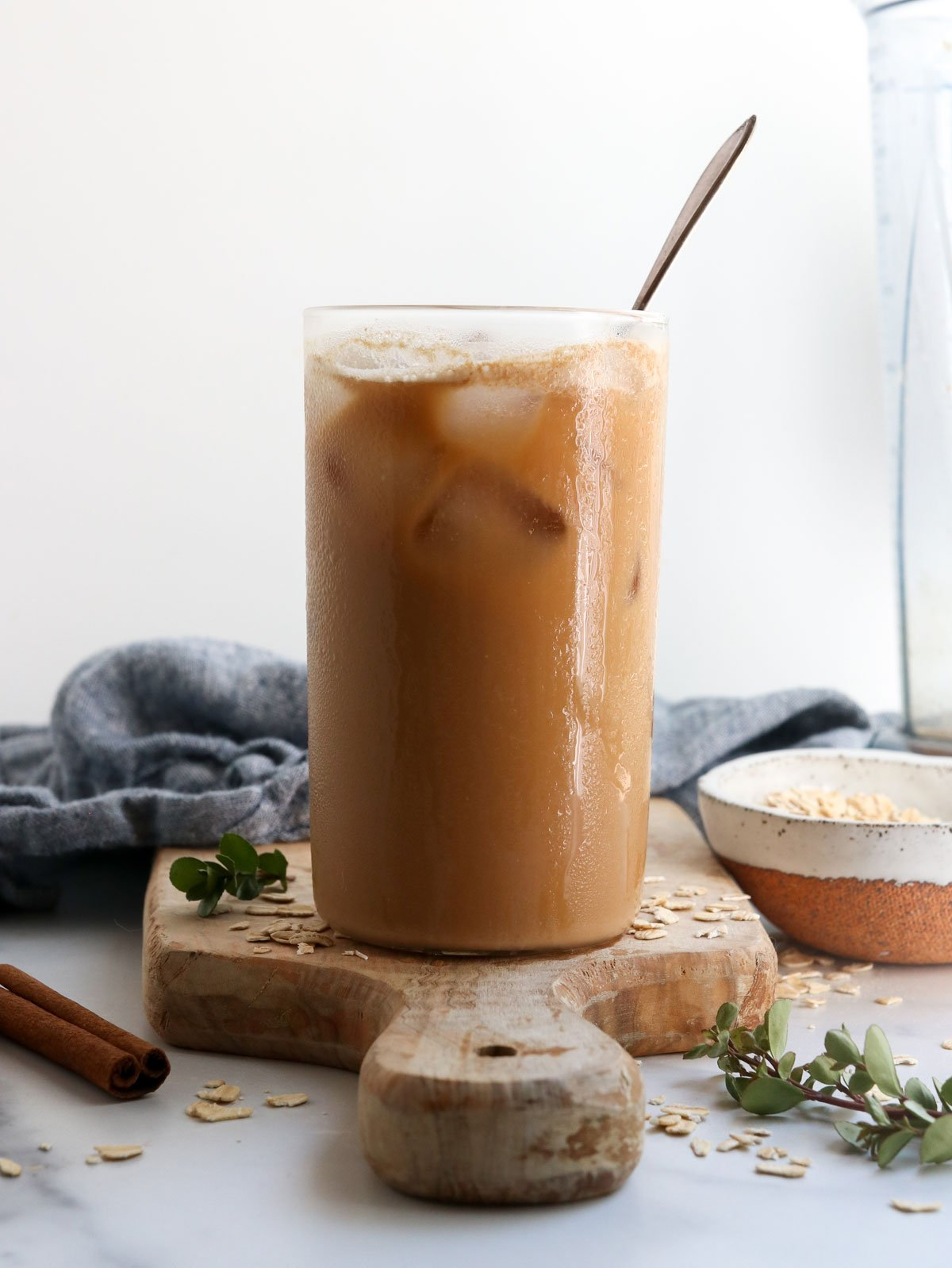 iced latte in glass with spoon