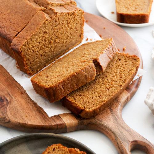 oat flour pumpkin bread sliced on board