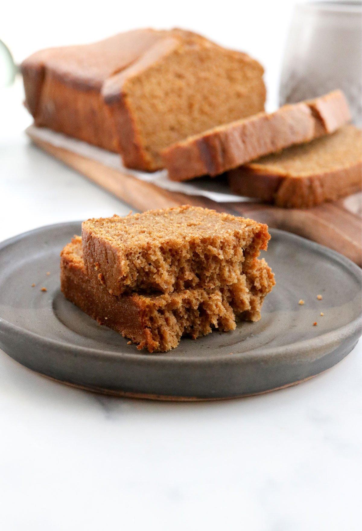 pumpkin bread slice in half on plate