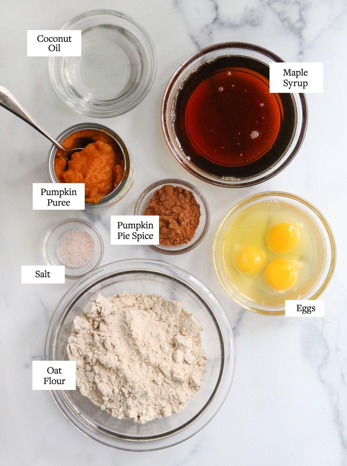 oat flour pumpkin bread ingredients in glass bowls
