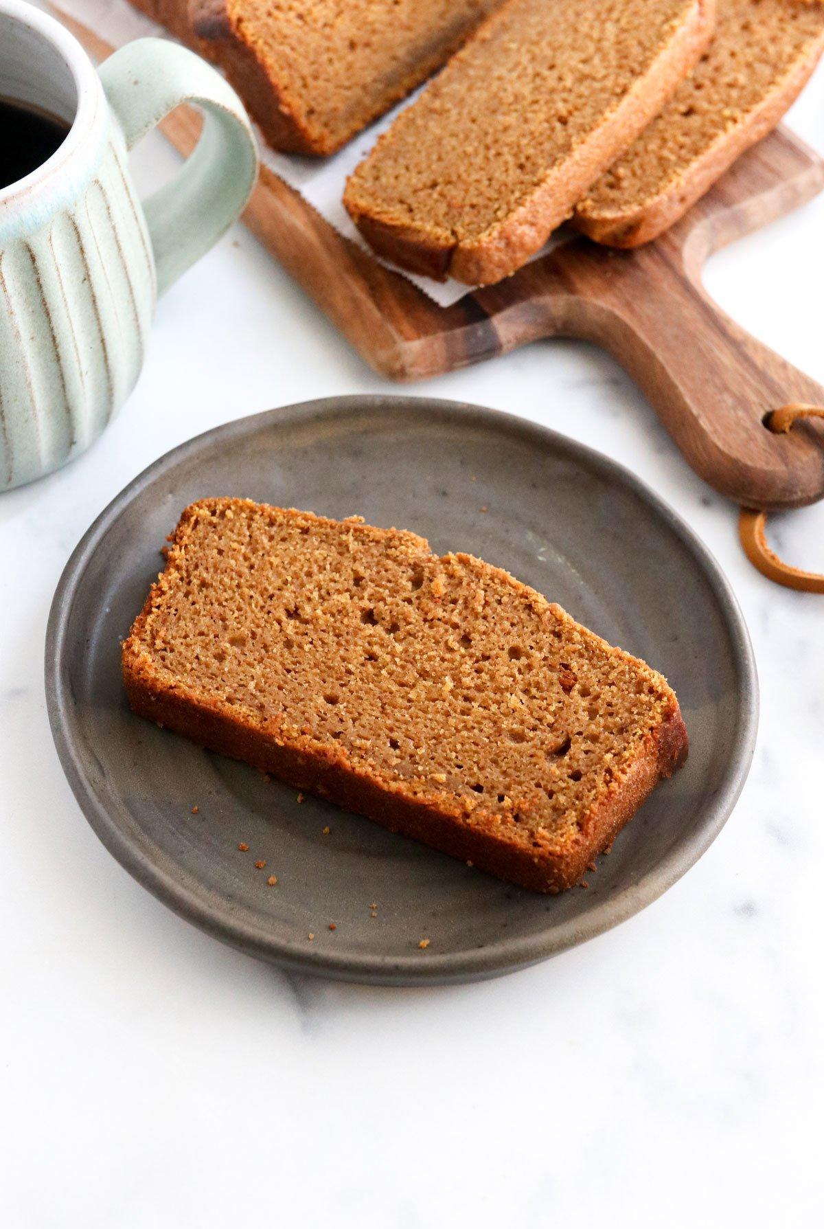 slice of pumpkin bread on black plate