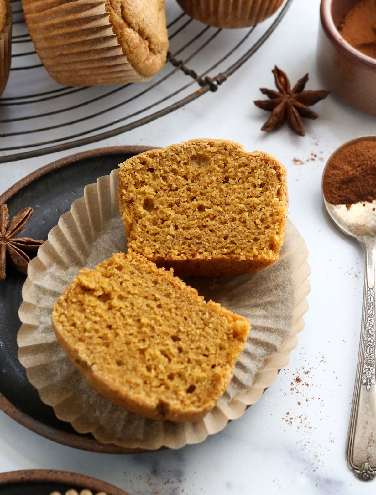 vegan pumpkin muffin cut in half on plate