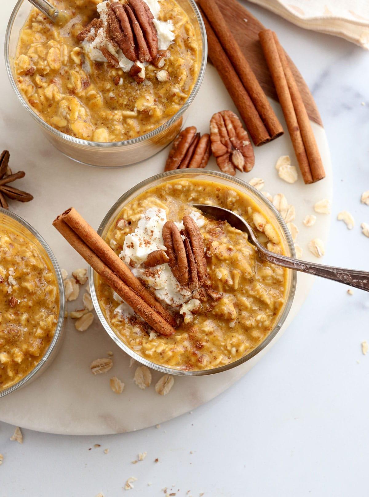 pumpkin spice overnight oats overhead on white surface