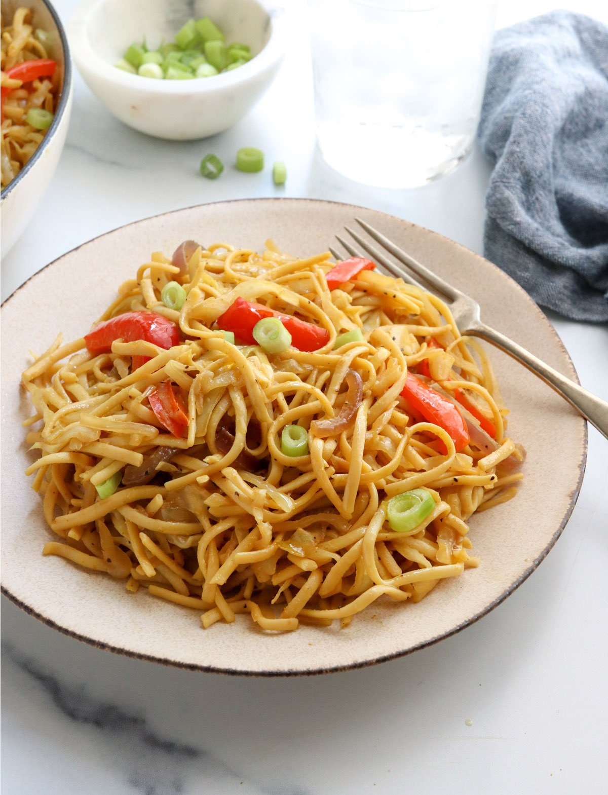 singapore noodles on plate with fork