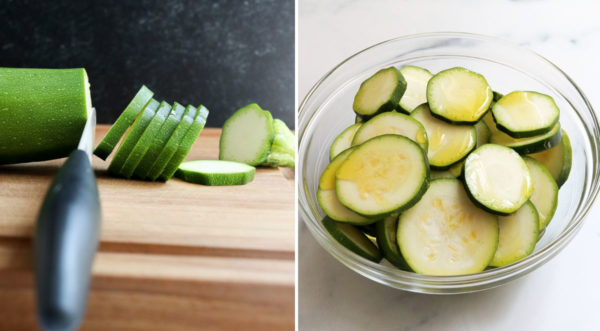 sliced zucchini added to bowl with oil