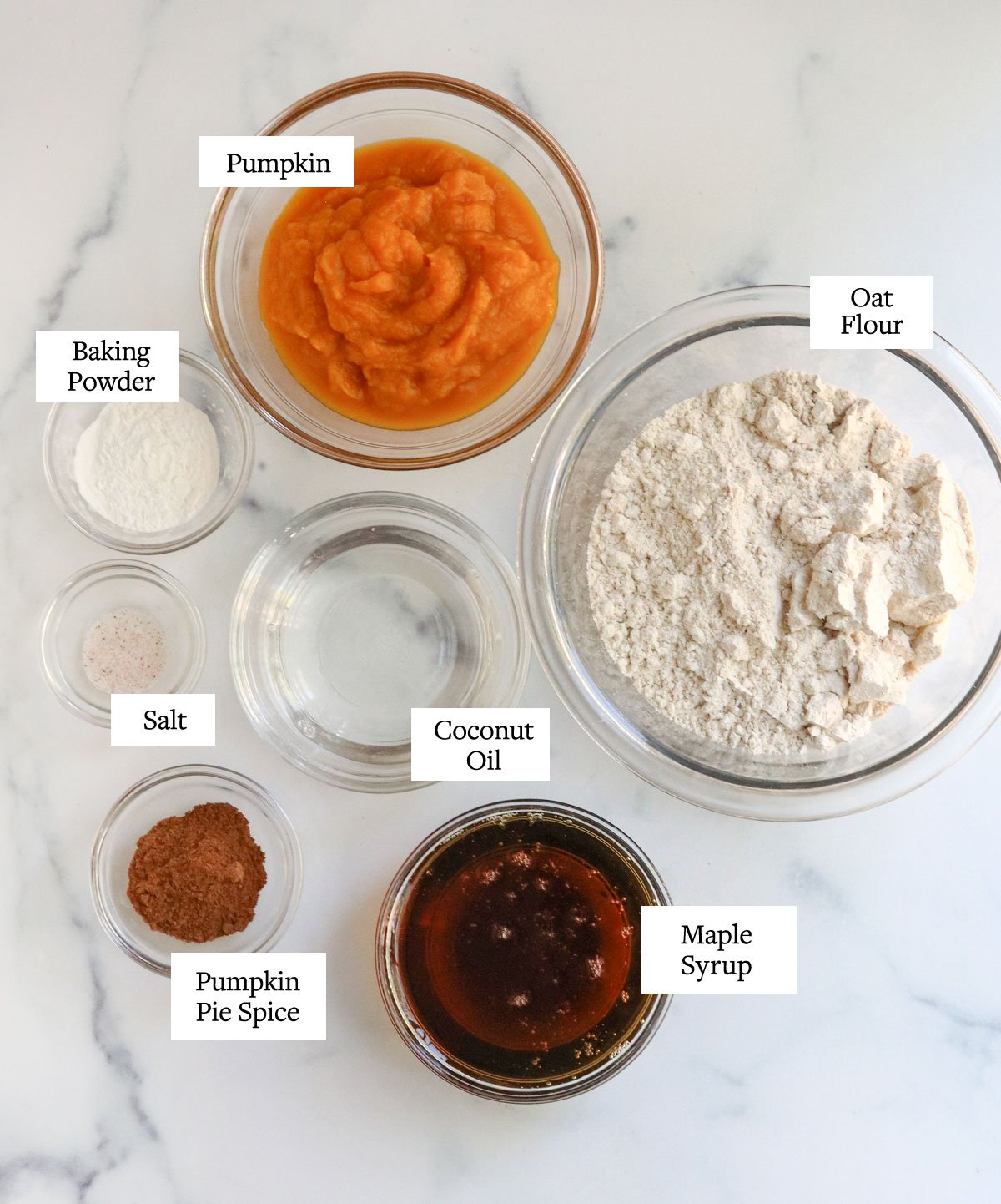 vegan pumpkin muffin ingredients in glass bowls