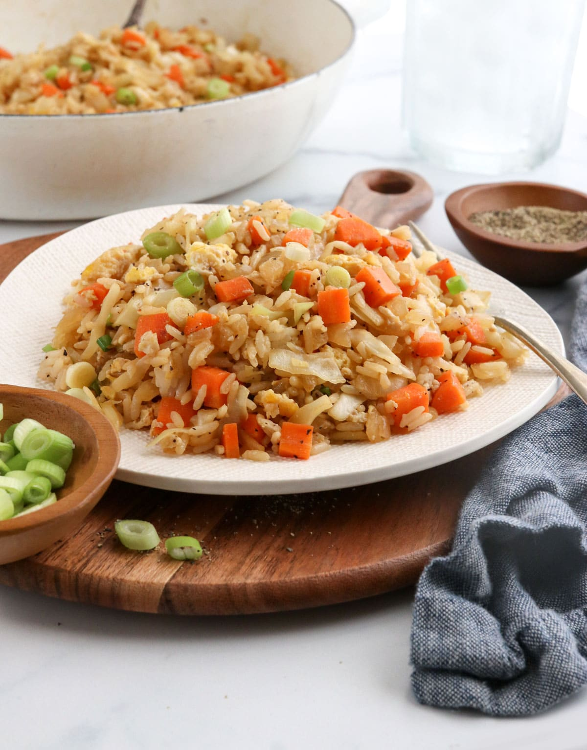 veggie fried rice on white plate with fork