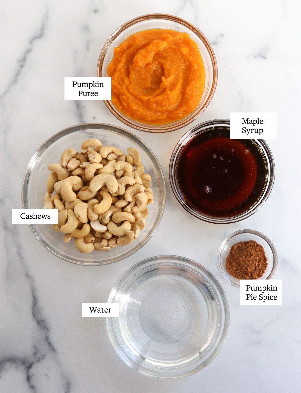 pumpkin ice cream ingredients in glass bowls