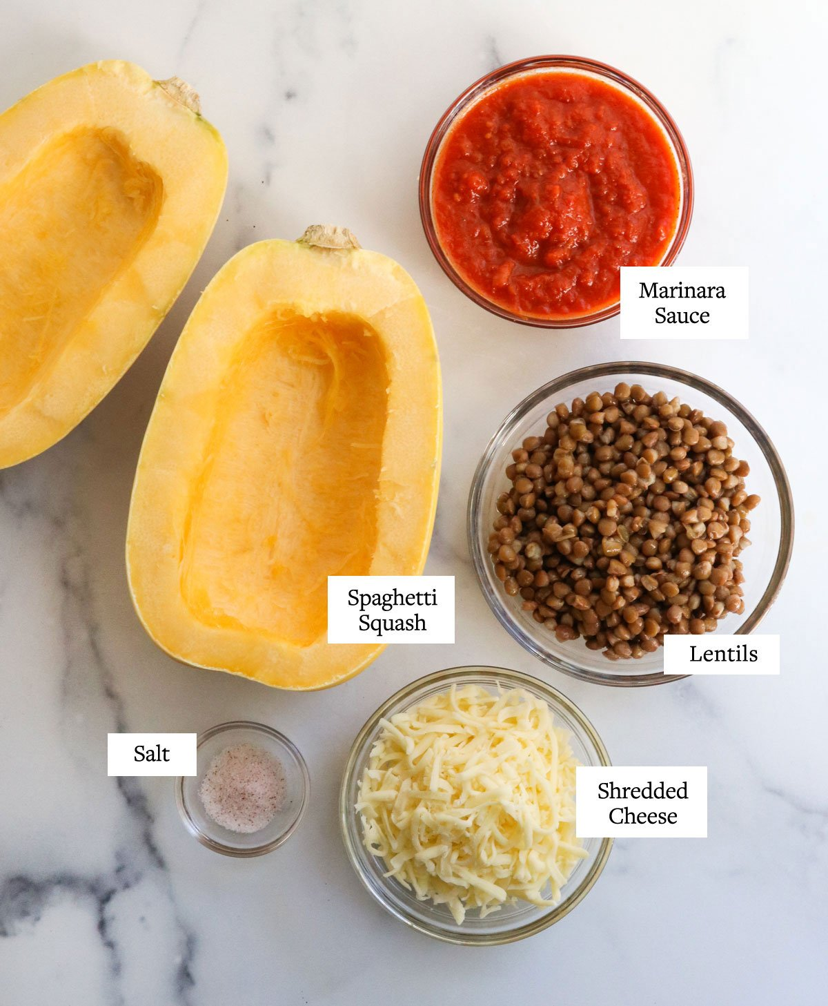 stuffed spaghetti squash ingredients on marble surface